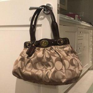 Tan and brown coach purse
